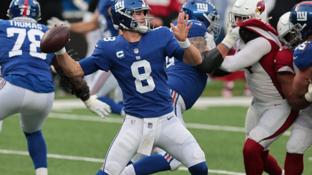 Dec 13, 2020; East Rutherford, New Jersey, USA; New York Giants quarterback Daniel Jones (8) throws a pass against the Arizona Cardinals during the second half at MetLife Stadium.