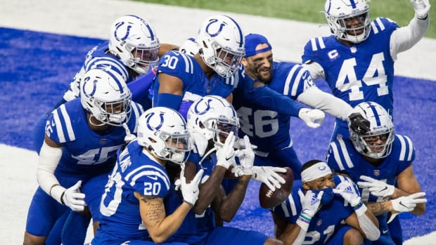 The Indianapolis Colts celebrate a fumble recovery to seal Sunday's 27-20 home win over the Houston Texans.