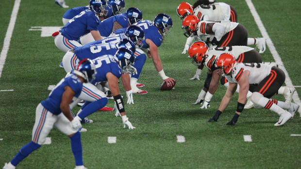 Dec 20, 2020; East Rutherford, New Jersey, USA; New York Giants quarterback Colt McCoy (12) takes a snap against the Cleveland Browns during the second quarter at MetLife Stadium.