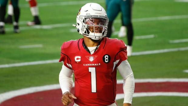 Cardinals' Kyler Murray (1) celebrates scoring a rushing touchdown against the Eagles during the first half at State Farm Stadium in Glendale, Ariz. on Dec. 20, 2020.