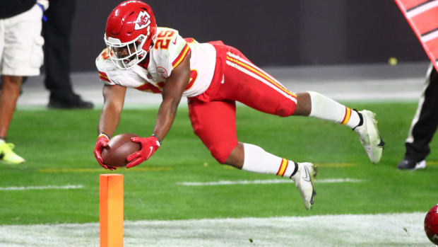 Nov 22, 2020; Paradise, Nevada, USA; Kansas City Chiefs running back Clyde Edwards-Helaire (25) dives across the goal line to score a touchdown in the third quarter against the Las Vegas Raiders at Allegiant Stadium. Mandatory Credit: Mark J. Rebilas-USA TODAY Sports