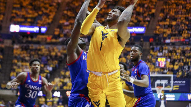 West Virginia Mountaineers forward Derek Culver (1) shoots while defended by Kansas Jayhawks center Udoka Azubuike (35) during the second half at WVU Coliseum.