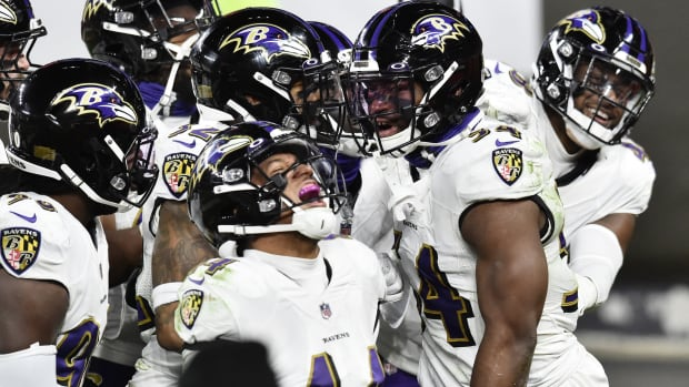 Dec 14, 2020; Cleveland, Ohio, USA; The Baltimore Ravens defense celebrates after linebacker Tyus Bowser (54) intercepted a pass from Cleveland Browns quarterback Baker Mayfield (not pictured) during the second half at FirstEnergy Stadium.