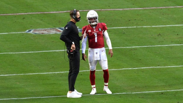 Arizona Cardinals head coach Kliff Kingsbury talks with Arizona Cardinals quarterback Kyler Murray (1) against the Philadelphia Eagles during the first half at State Farm Stadium.