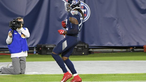 Tennessee Titans running back Derrick Henry (22) stands in the end zone after scoring a touchdown during the second half at Nissan Stadium.