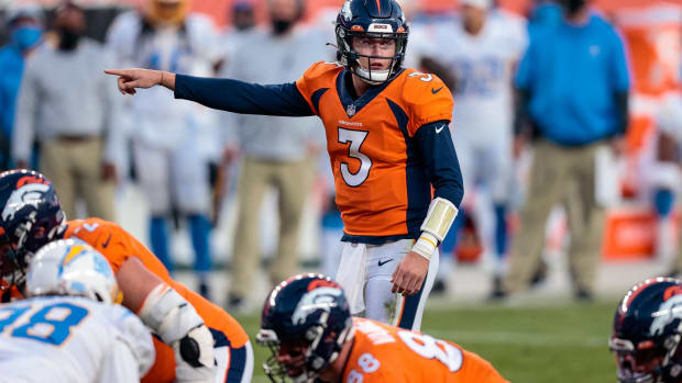 Denver Broncos quarterback Drew Lock (3) motions at the line of scrimmage in the fourth quarter against the Los Angeles Chargers at Empower Field at Mile High.