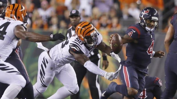 Sep 14, 2017; Cincinnati, OH, USA; Houston Texans quarterback Deshaun Watson (4) escapes a tackle from Cincinnati Bengals linebacker Carl Lawson (58) during the second half at Paul Brown Stadium. Mandatory Credit: David Kohl-USA TODAY Sports