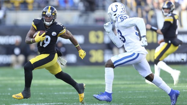 Pittsburgh Steelers wide receiver JuJu Smith-Schuster (19) tries to elude Indianapolis Colts linebacker Darius Leonard (53) in a 2019 game at Pittsburgh's Heinz Field.