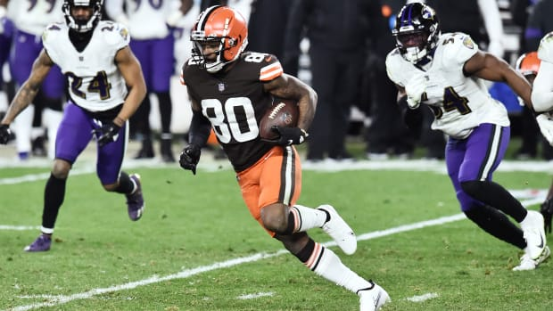 Dec 14, 2020; Cleveland, Ohio, USA; Cleveland Browns wide receiver Jarvis Landry (80) runs with the ball after a catch as Baltimore Ravens cornerback Marcus Peters (24) and linebacker Tyus Bowser (54) defend during the second half at FirstEnergy Stadium.