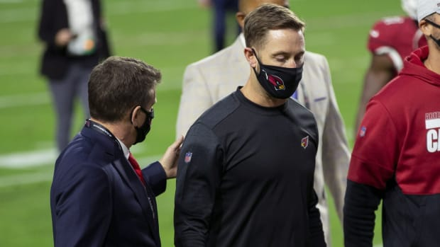 Arizona Cardinals owner Michael Bidwill and Arizona Cardinals head coach Kliff Kingsbury walk off the field following the game against the San Francisco 49ers at State Farm Stadium.