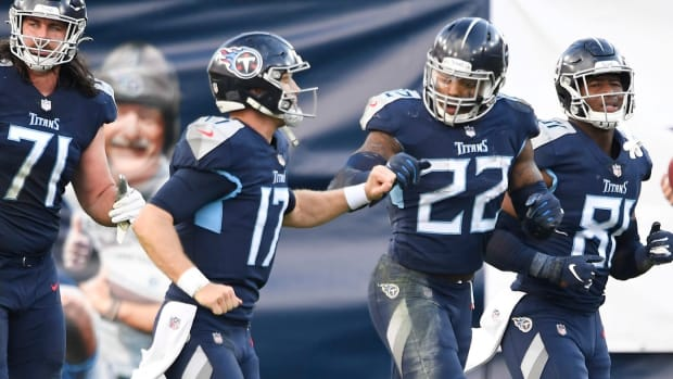 Tennessee Titans quarterback Ryan Tannehill (17) celebrates his touchdown and the two-point conversion by running back Derrick Henry (22) during the fourth quarter against the Detroit Lions at Nissan Stadium Sunday, Dec. 20, 2020 in Nashville, Tenn.
