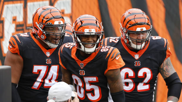 Oct 25, 2020; Cincinnati, Ohio, USA; Cincinnati Bengals wide receiver Tee Higgins (85) celebrates his touchdown with Fred Johnson (74) and offensive guard Alex Redmond (62) late in the fourth quarter against the Cleveland Browns at Paul Brown Stadium. Mandatory Credit: Joseph Maiorana-USA TODAY Sports