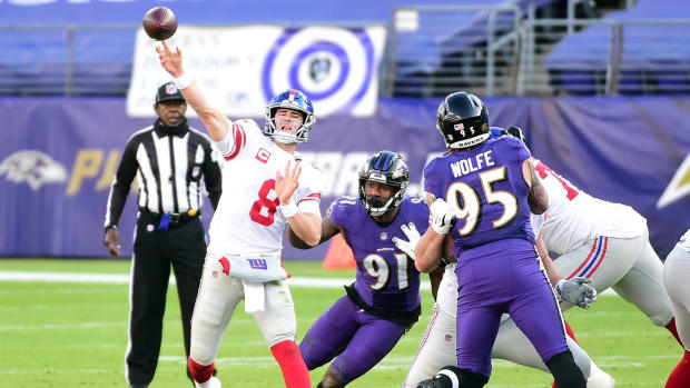 Dec 27, 2020; Baltimore, Maryland, USA; New York Giants quarterback Daniel Jones (8) throws a pass in the third quarter against the Baltimore Ravens at M&T Bank Stadium.