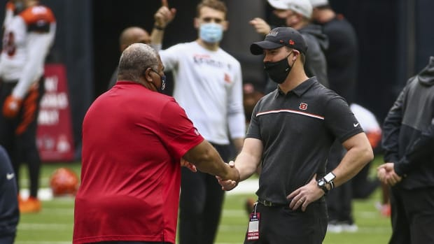 Dec 27, 2020; Houston, Texas, USA; Houston Texans head coach Romeo Crennel and Cincinnati Bengals head coach Zac Taylor greet each other before a game at NRG Stadium. Mandatory Credit: Troy Taormina-USA TODAY Sports