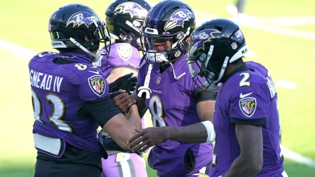 Dec 27, 2020; Baltimore, Maryland, USA; Baltimore Ravens quarterback Lamar Jackson (8) greets wide receiver Willie Snead IV (83) prior to the game against the New York Giants at M&T Bank Stadium.