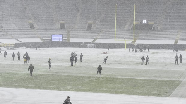 Players warm up at Lambeau Field before game between the Green Bay Packers and Tennessee Titans.