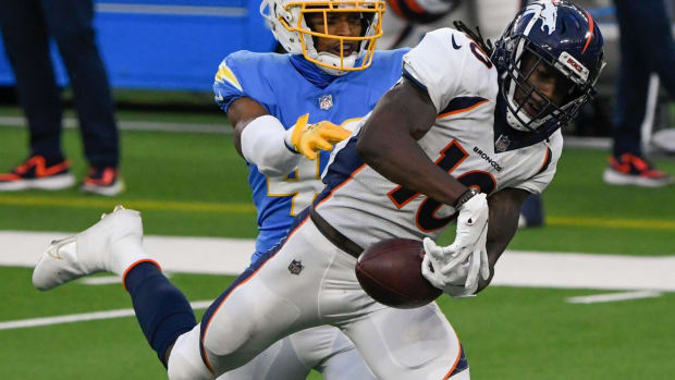Denver Broncos wide receiver Jerry Jeudy (10) drops a pass while defended by Los Angeles Chargers cornerback Michael Davis (43) in the fourth quarter at SoFi Stadium.