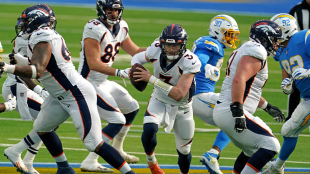Denver Broncos quarterback Drew Lock (3) runs with the ball against the Los Angeles Chargers during the first half at SoFi Stadium.