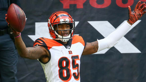 Dec 27, 2020; Houston, Texas, USA; Cincinnati Bengals wide receiver Tee Higgins (85) reacts after making a reception for a touchdown against the Houston Texans during the third quarter at NRG Stadium. Mandatory Credit: Troy Taormina-USA TODAY Sports