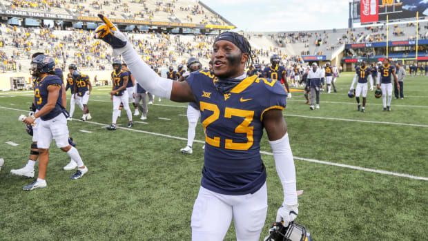 Nov 14, 2020; Morgantown, West Virginia, USA; West Virginia Mountaineers safety Tykee Smith (23) celebrates after defeating the TCU Horned Frogs at Mountaineer Field at Milan Puskar Stadium.