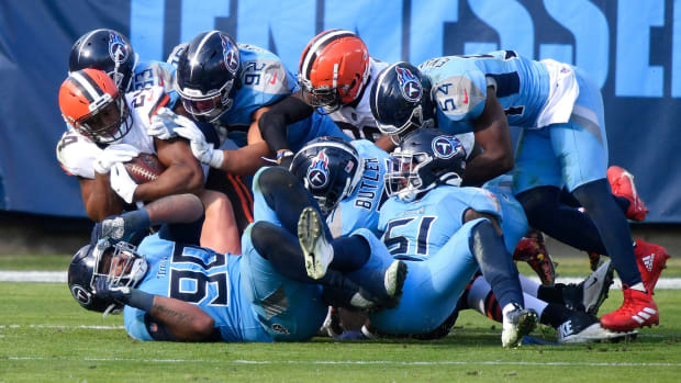 Cleveland Browns running back Nick Chubb (24) is brought down by the Tennessee Titans defense during the second quarter at Nissan Stadium Sunday, Dec. 6, 2020 in Nashville, Tenn.