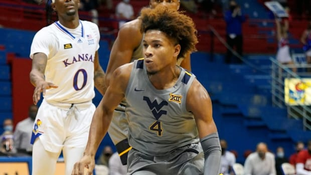 Dec 22, 2020; Lawrence, Kansas, USA; West Virginia Mountaineers guard Miles McBride (4) dribbles the ball against the Kansas Jayhawks during the second half at Allen Fieldhouse.