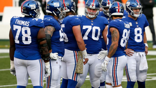 New York Giants offensive guard Kevin Zeitler (70) talks n the huddle before a play in the second quarter of the NFL Week 12 game between the Cincinnati Bengals and the New York Giants at Paul Brown Stadium in Cincinnati on Sunday, Nov. 29, 2020. The game was tied at 10 going into halftime.