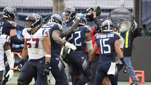 Tennessee Titans running back Derrick Henry (22) and his teammates celebrate the overtime win on a five yard touchdown run during the over time period at Nissan Stadium.