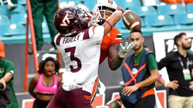 Miami Hurricanes wide receiver K.J. Osborn (2) is unable to make a catch as Virginia Tech Hokies defensive back Caleb Farley (3) defends the play during the second half at Hard Rock Stadium.