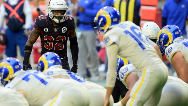 Arizona Cardinals strong safety Budda Baker (32) looks down Los Angeles Rams quarterback Jared Goff (16) during the first half at State Farm Stadium.