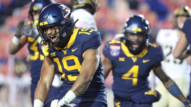 West Virginia Mountaineers defender Scottie Young celebrates a stop on third down against the Army Black Knightsduring the AutoZone Liberty Bowl in Memphis, Tenn. on Thursday, Dec. 31, 2020