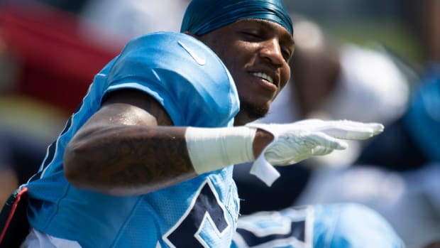 Tennessee Titans outside linebacker Derick Roberson (50) dances to the music as he stretches during a training camp practice at Saint Thomas Sports Park Monday, Aug. 24, 2020 Nashville, Tenn.