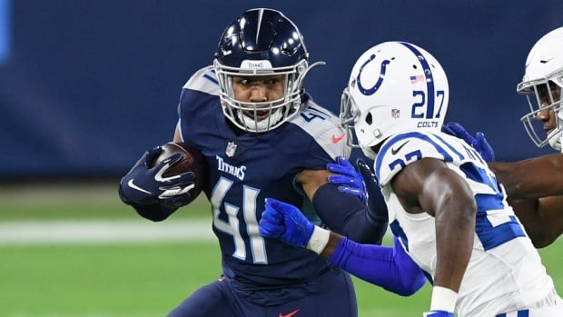 Tennessee Titans fullback Khari Blasingame (41) is defended by Indianapolis Colts cornerback Xavier Rhodes (27) and linebacker Bobby Okereke (58) during the first quarter at Nissan Stadium Thursday, Nov. 12, 2020 in Nashville, Tenn.