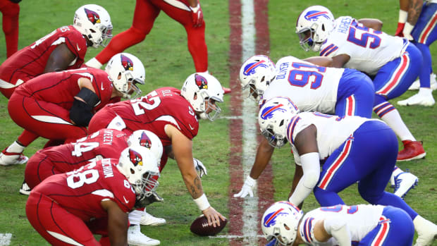 General view down the line of scrimmage as Arizona Cardinals center Mason Cole (52) prepares to snap the ball against the Buffalo Bills at State Farm Stadium.
