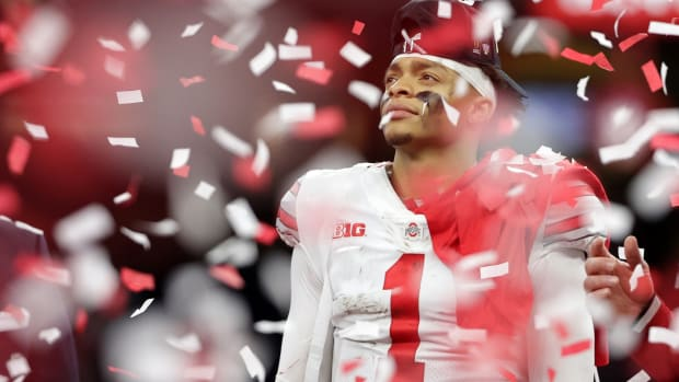 Jan 1, 2021; New Orleans, LA, USA; Ohio State Buckeyes quarterback Justin Fields (1) celebrates after defeating the Clemson Tigers at Mercedes-Benz Superdome. Mandatory Credit: Derick E. Hingle-USA TODAY Sports