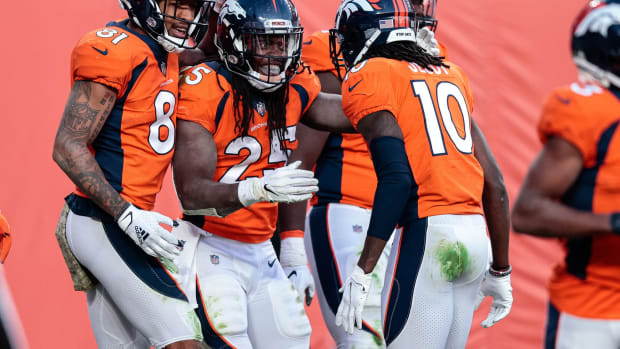 Denver Broncos running back Melvin Gordon III (25) celebrates his touchdown with wide receiver Jerry Jeudy (10) and wide receiver Tim Patrick (81) in the third quarter against the Miami Dolphins at Empower Field at Mile High.