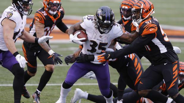 Jan 3, 2021; Cincinnati, Ohio, USA; Baltimore Ravens running back Gus Edwards (35) tackled by Cincinnati Bengals linebacker Germaine Pratt (57) during the second half at Paul Brown Stadium. Mandatory Credit: Joseph Maiorana-USA TODAY Sports