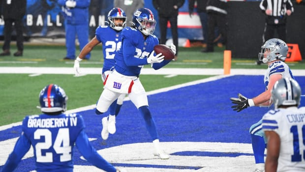 Jan 3, 2021; East Rutherford, NJ, USA; New York Giants safety Xavier McKinney (29) intercepts a pass in the end zone intended for Dallas Cowboys tight end Dalton Schultz (86) in the second half at MetLife Stadium.