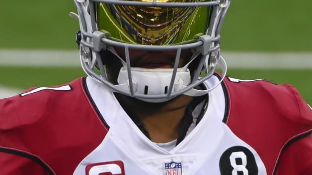 Arizona Cardinals quarterback Kyler Murray has SoFi Stadium reflected in his face shield as he takes the field for pregame warmups before playing against the Los Angeles Rams.