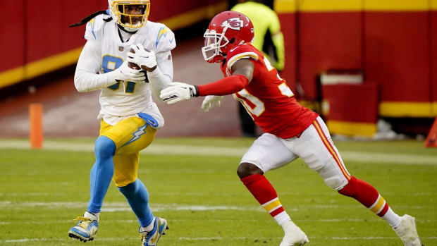 Jan 3, 2021; Kansas City, Missouri, USA; Los Angeles Chargers wide receiver Mike Williams (81) catches a pass against Kansas City Chiefs cornerback Deandre Baker (30) during the first half at Arrowhead Stadium. Mandatory Credit: Jay Biggerstaff-USA TODAY Sports