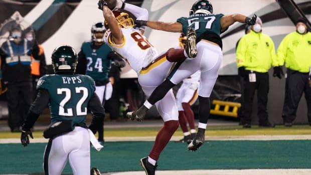 Jan 3, 2021; Philadelphia, Pennsylvania, USA; Washington Football Team tight end Logan Thomas (82) makes a touchdown catch past Philadelphia Eagles linebacker T.J. Edwards (57) during the second quarter at Lincoln Financial Field.