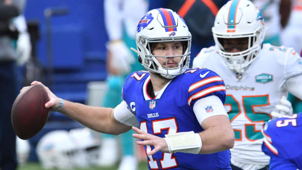 Buffalo Bills quarterback Josh Allen throws during Sunday's home win over the Miami Dolphins. The Bills locked up the AFC's No. 2 seed for the playoffs.