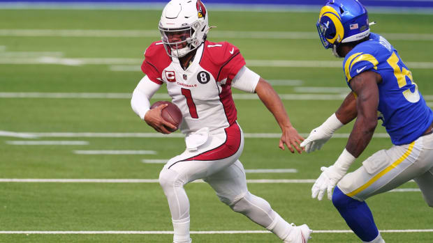 Arizona Cardinals quarterback Kyler Murray (1) is pursued by Los Angeles Rams outside linebacker Leonard Floyd (54) in the first quarter at SoFi Stadium. The Rams defeated the Cardinals 18-7.