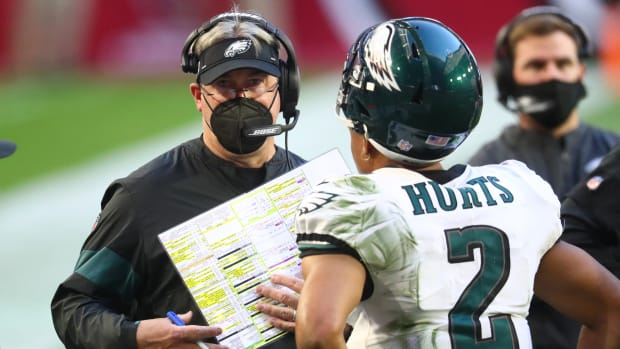 Eagles coach Doug Pederson on the sideline with Jalen Hurts