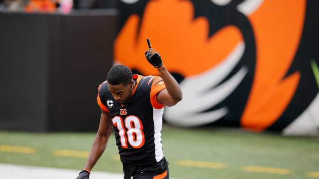 Cincinnati Bengals wide receiver A.J. Green (18) raises a hand as he's introduced for what might be his final game with the team before the first quarter of the NFL Week 17 game between the Cincinnati Bengals and the Baltimore Ravens at Paul Brown Stadium in downtown Cincinnati on Sunday, Jan. 3, 2021. The Ravens led 17-3 at half time. Baltimore Ravens At Cincinnati Bengals