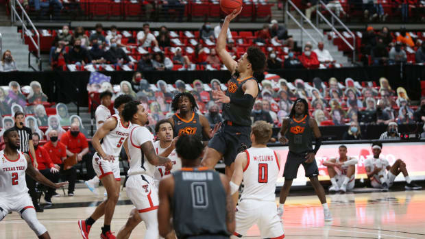 Oklahoma State Cowboys guard Cade Cunningham (2) goes to the basket against the Texas Tech Red Raiders in the first half at United Supermarkets Arena.