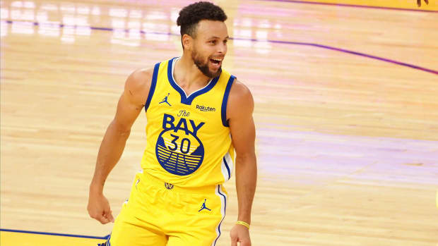 Golden State Warriors guard Stephen Curry celebrates after a basket against the Portland Trail Blazers during the fourth quarter for a career-high 62 point game
