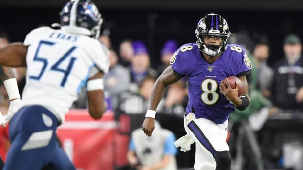 Baltimore Ravens quarterback Lamar Jackson (8) advances against the Tennessee Titans during the first quarter of a NFL Divisional Playoff game at M&T Bank Stadium Saturday, Jan. 11, 2020 in Baltimore, Md.