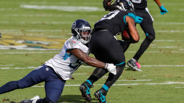 Tennessee Titans linebacker David Long (51) tackles Jacksonville Jaguars wide receiver Laviska Shenault Jr. (10) during the second quarter at TIAA Bank Field.