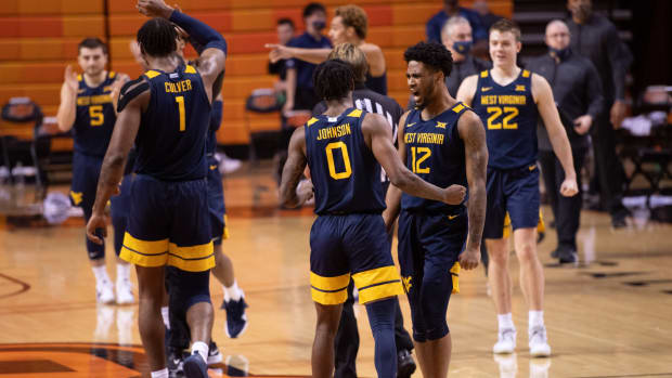West Virginia Mountaineers guard Kedrian Johnson (0) and guard Taz Sherman (12) celebrate after defeating the Oklahoma State Cowboys 87-84 at Gallagher-Iba Arena.